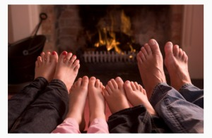 family-feet-by-fireplace